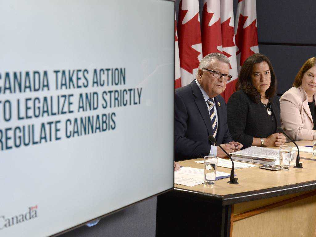 From left, Minister of Public Safety and Emergency Preparedness Ralph Goodale, Justice Minister and Attorney General of Canada Jody Wilson-Raybould, and Health Minister Jane Philpott announce changes regarding the legalization of marijuana during a news conference in Ottawa on Thursday.