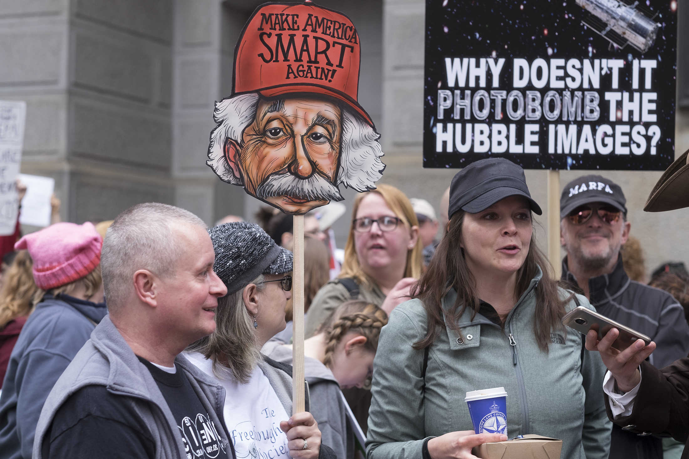 Science supporters carried signs and chanted protests at the rally in Philadelphia, one of hundreds held worldwide.