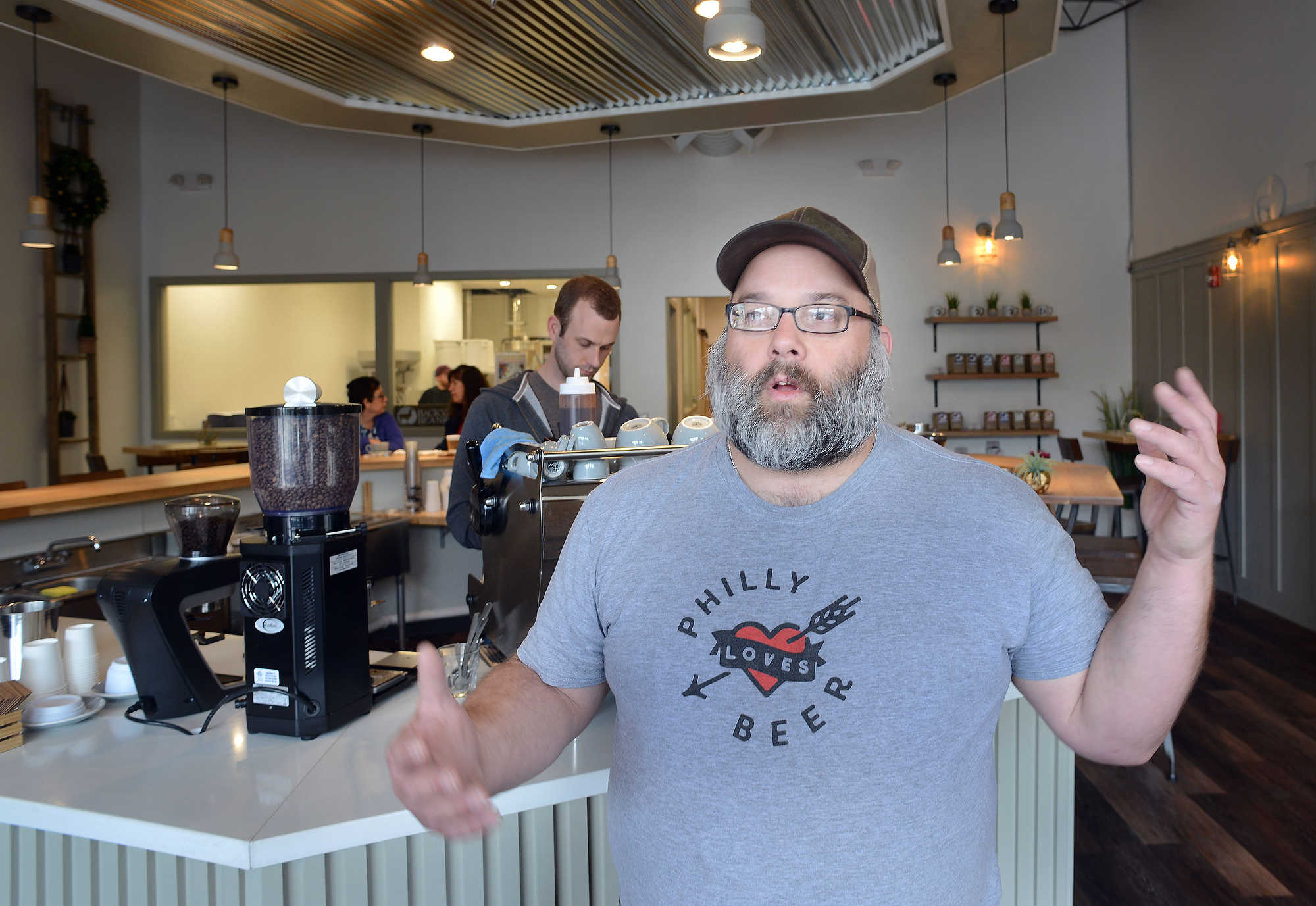 Scott Rudich, owner of Round Guys Brewery stands in the coffee cafe as he speaks about his new partnership in a coffee company and performance space at Backyard Beans Coffee Company.