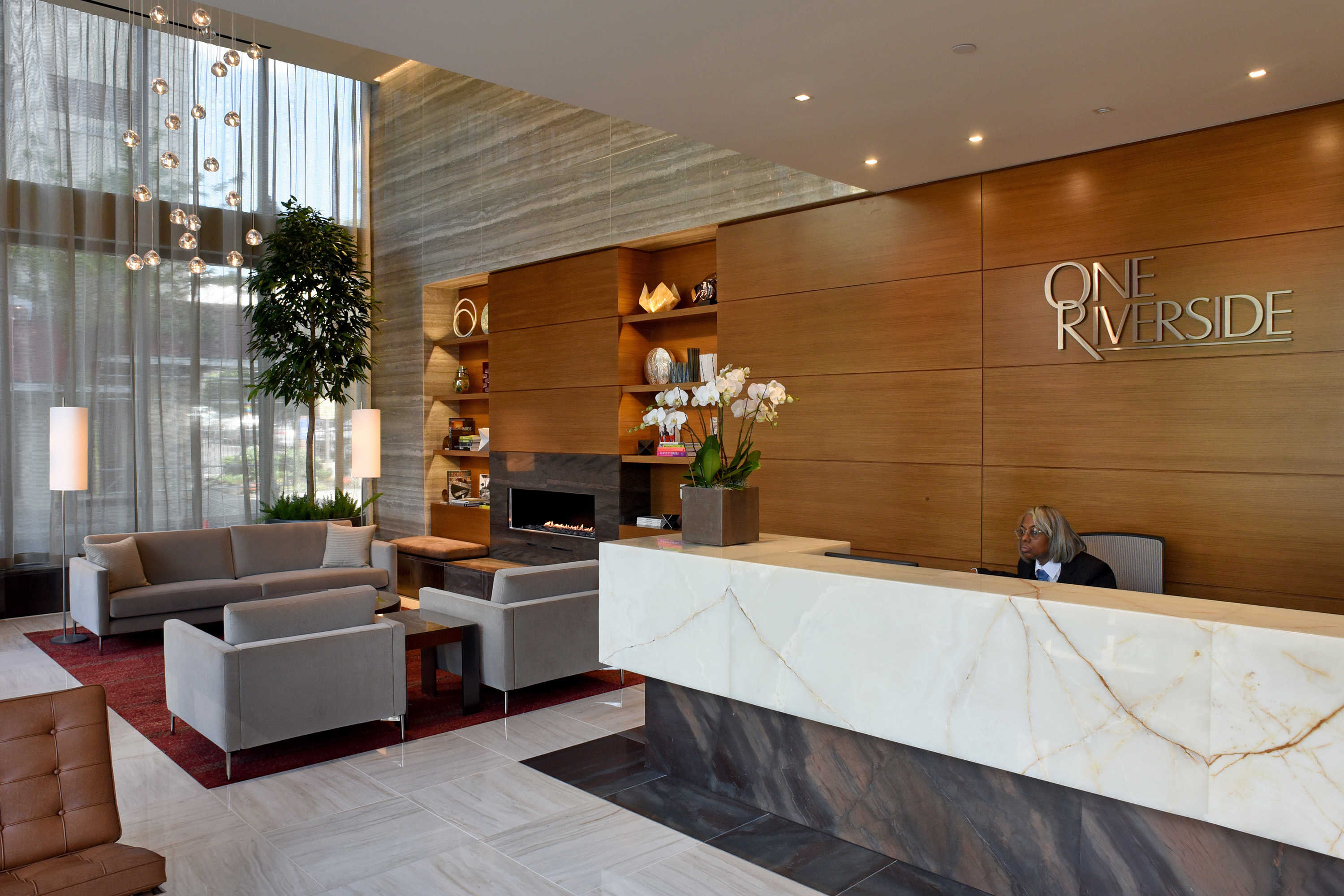 Alice Dunham works the front desk, in the lobby at One Riverside.