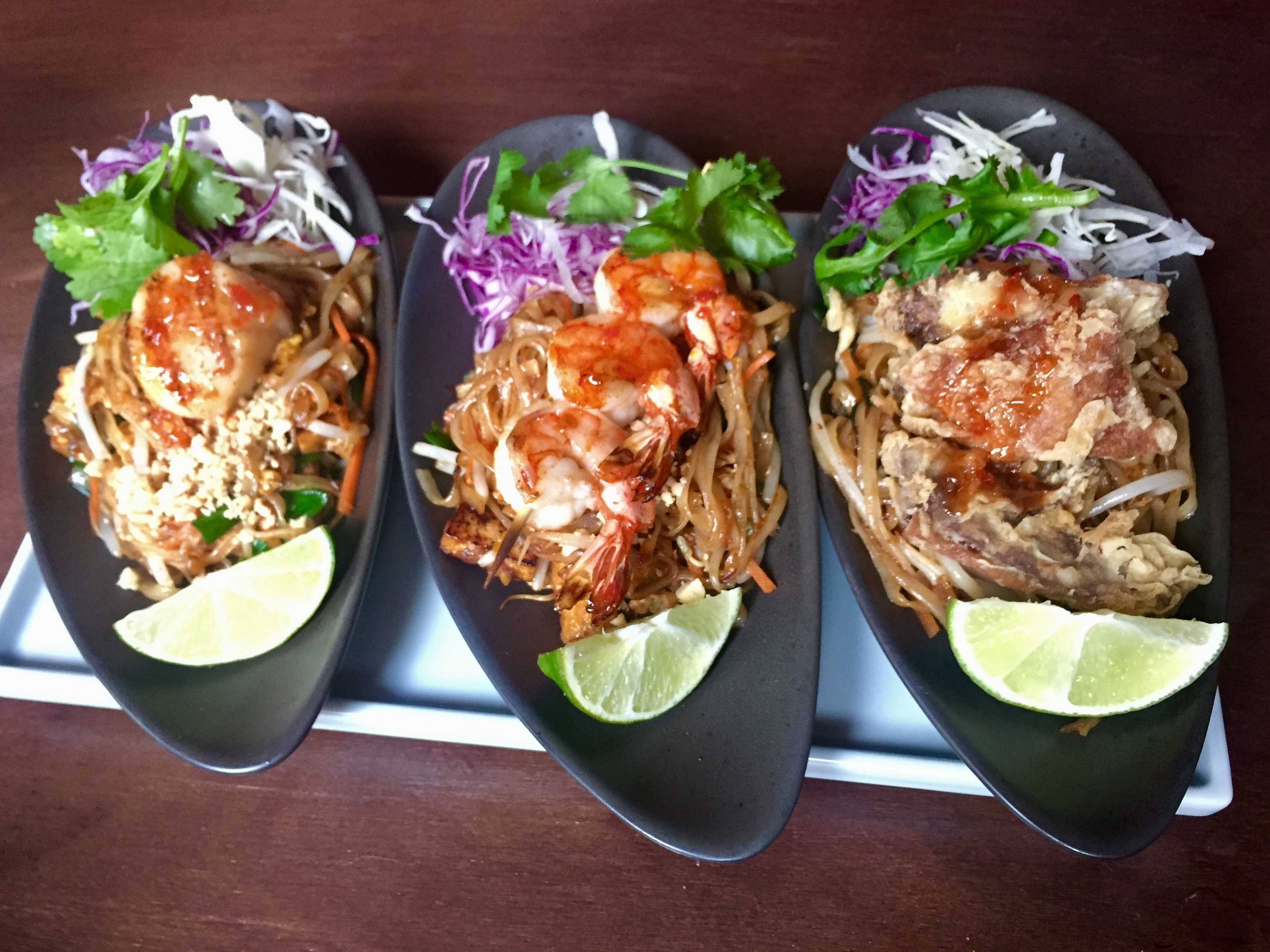 """A pad Thai """"flight"""" topped with scallops, shrimp and duck at... Chabaa Thai.  4343 Main St. in Manayunk."""