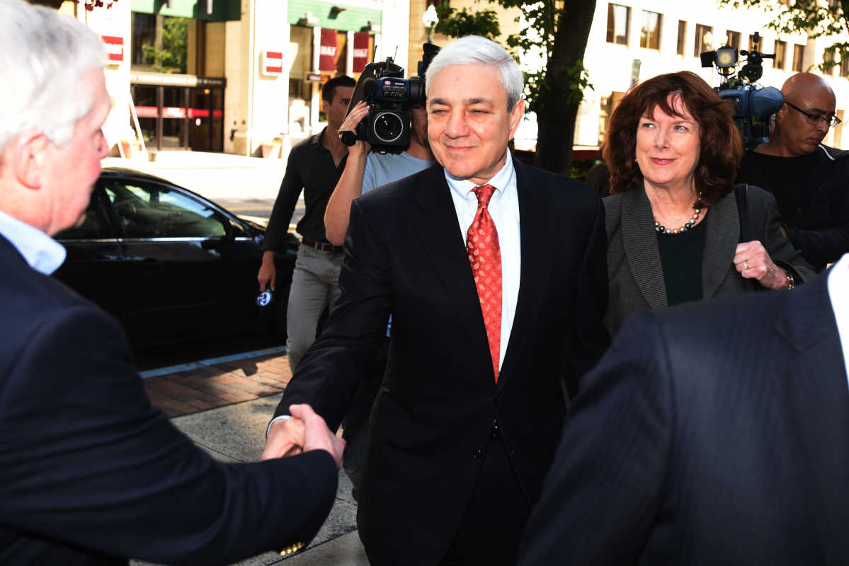 Former Penn State President Graham Spanier second from left, arrives for his sentencing at the Dauphin County Courthouse Friday June 2, 2017 in Harrisburg, Pa.