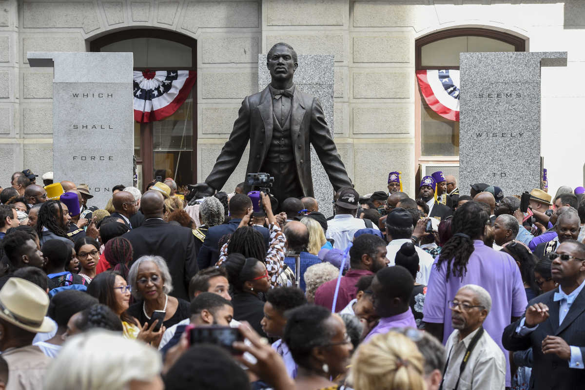 People who attended the dedication of the Octavious Catto Memorial mill around the statue of Catto on the southwest corner of City Hall after the ceremony September 26, 2017. The statue is the first of an African American hero on city property.
