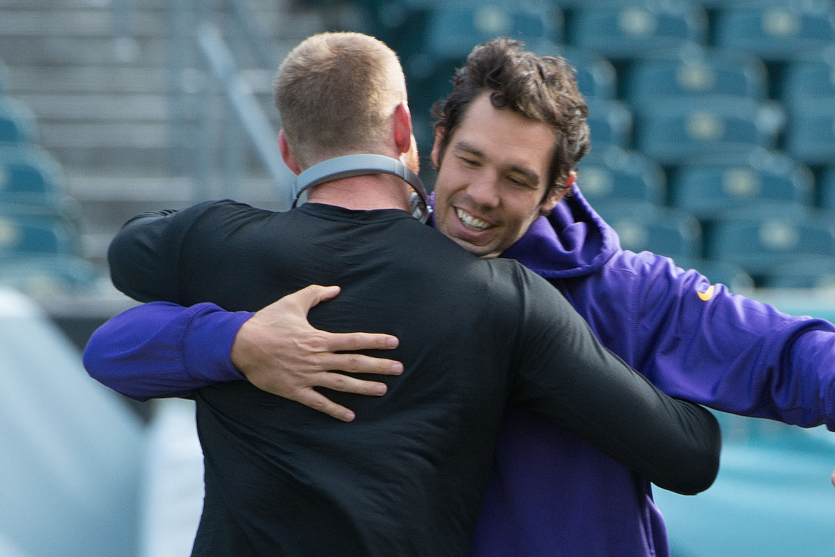 Former teammates Sam Bradford (right) and Carson Wentz hug before the Eagles-Vikings game at Lincoln Financial Field on Sunday, Oct. 23, 2016.