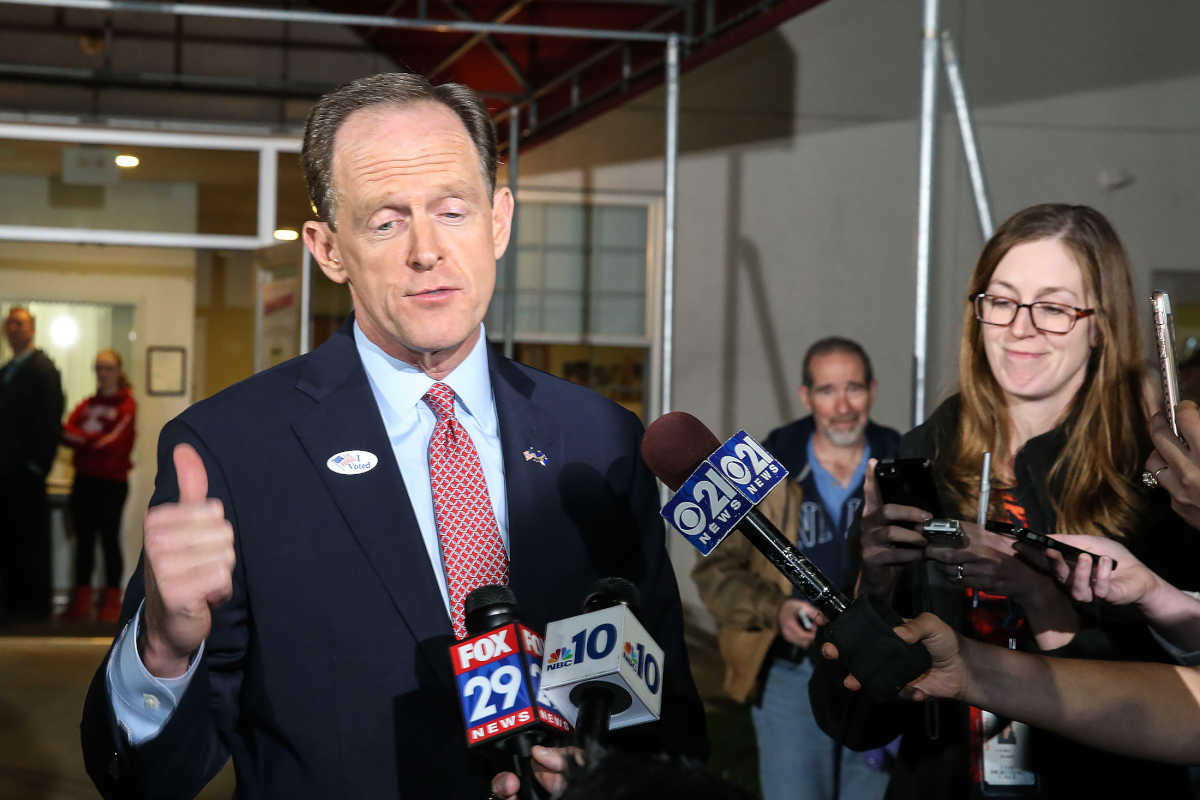 Sen Pat Toomey talks with the media after voting in Zionsville, Pa.