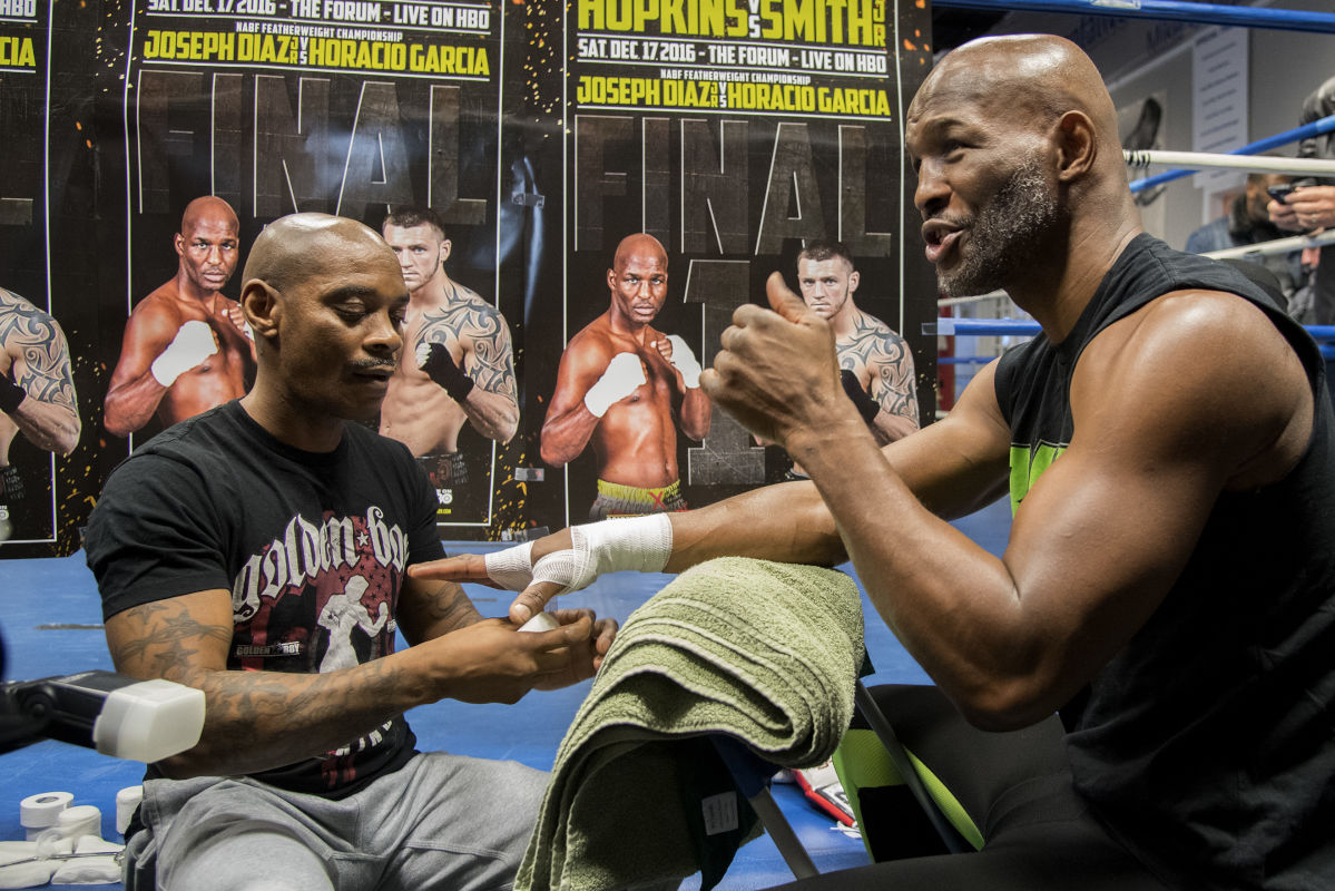 Bernard Hopkins answers questions from reporters as he gets his hands taped before his workout.