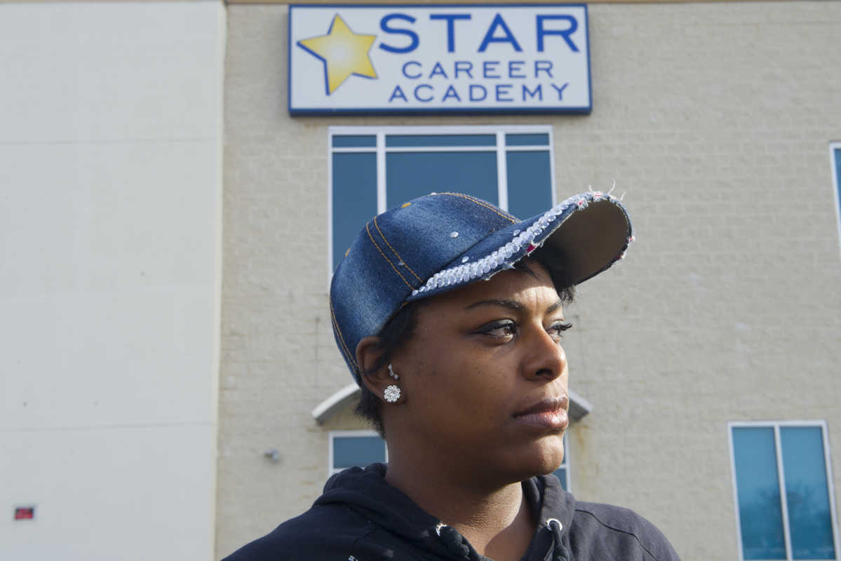 Latoya Cobb stands in front of the now-shuttered Star Career Academy in Northeast Philadelphia. The for-profit education company shut down without warning on Nov. 15.