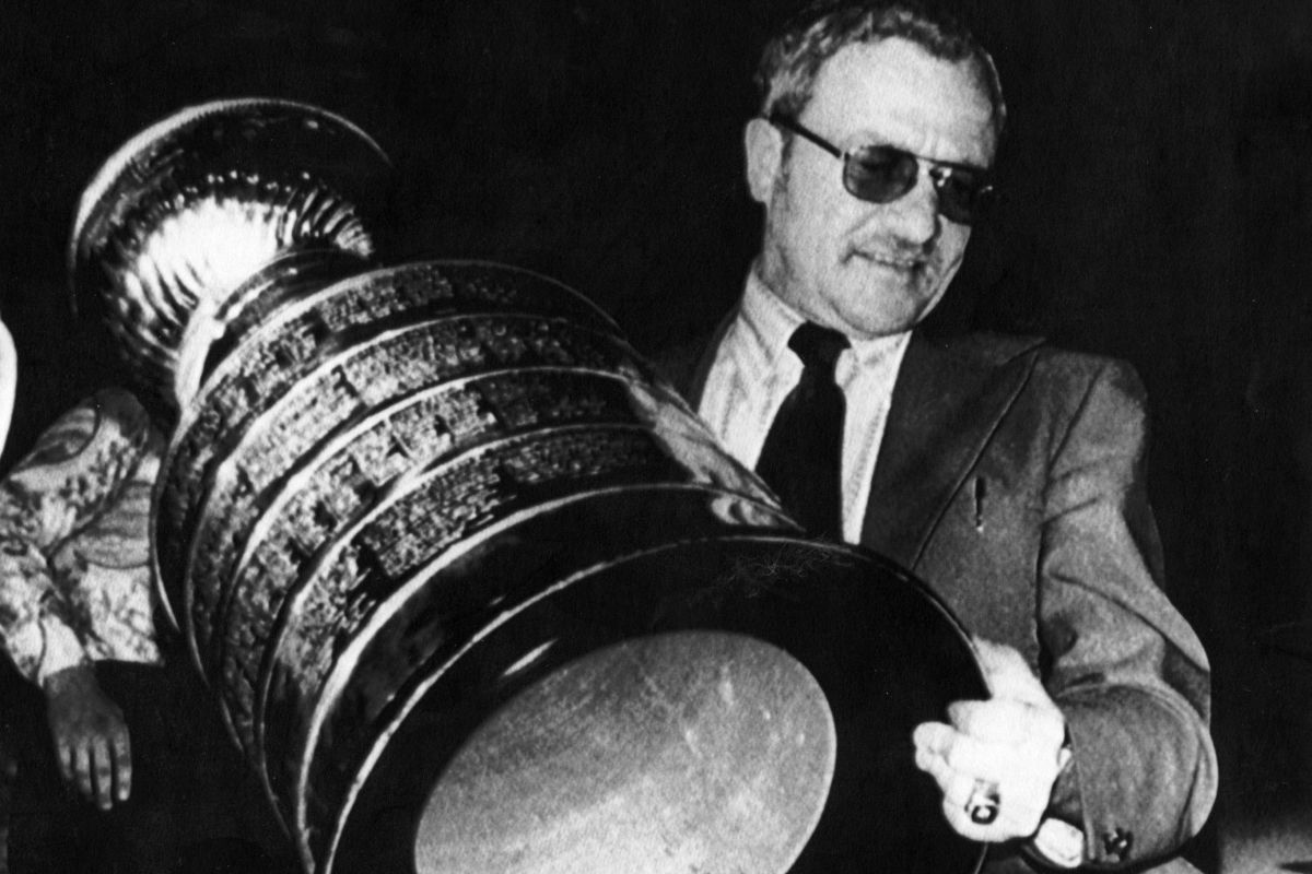 HIST:  Fred Shero carries the Stanley Cup off a plane after the Philadelphia Flyers clinched the playoffs from the Buffalo Sabres in this 1975 photo. AP FILE PHOTO  B&W only