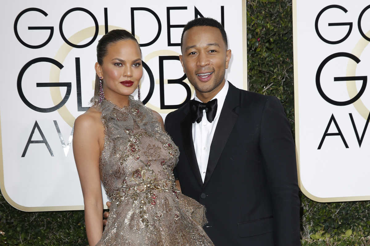 Chrissy Teigen and husband John Legend arrive at the 74th annual Golden Globe Awards in Beverly Hills, Calif., on Jan. 8, 2017.