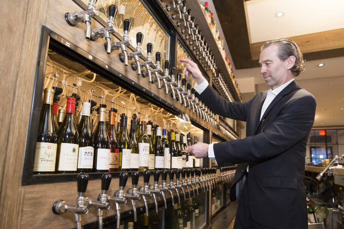 William Eccleston pours a glass of wine at Ristorante Panorama.