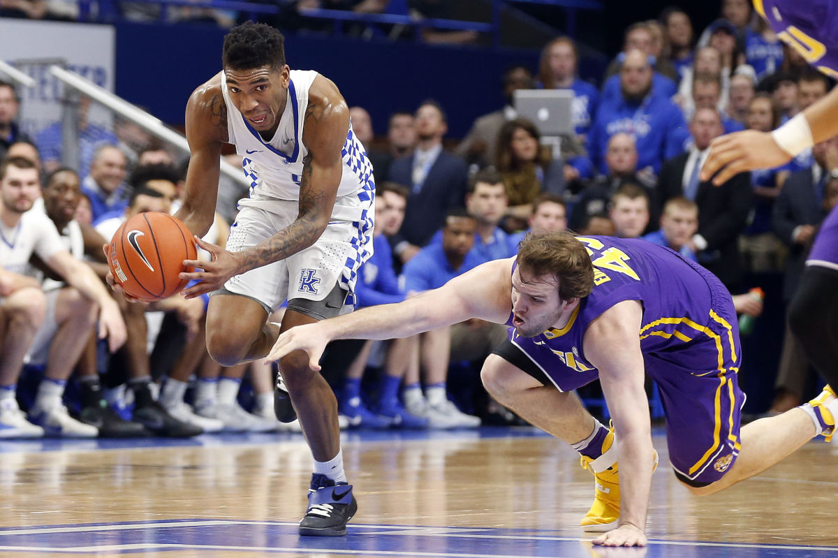 Kentucky guard Malik Monk (5) comes up with a loose ball against LSU forward Brandon Eddlestone on Tuesday, Feb. 7, 2017 in Rupp Arena in Lexington, Ky.
