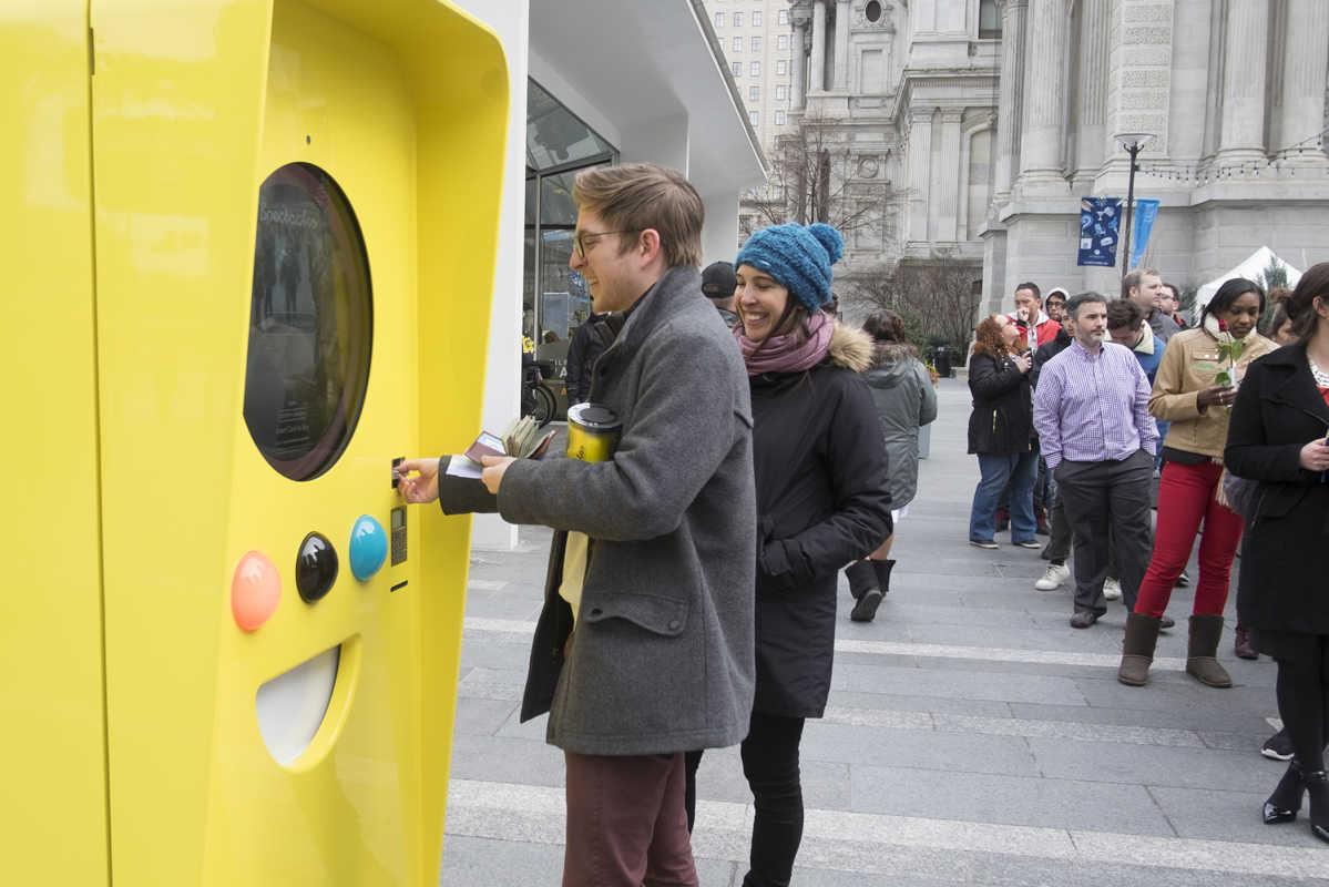 Alex Bogden, 26, of Philadelphia, makes his purchase at the Snapchat kiosk in Dilworth Park.