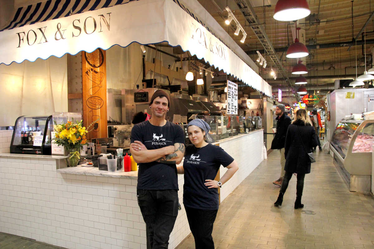 Ezekial Ferguson and Rebecca Foxman at Fox & Son Fancy Corndogs, their stand at Reading Terminal Market.
