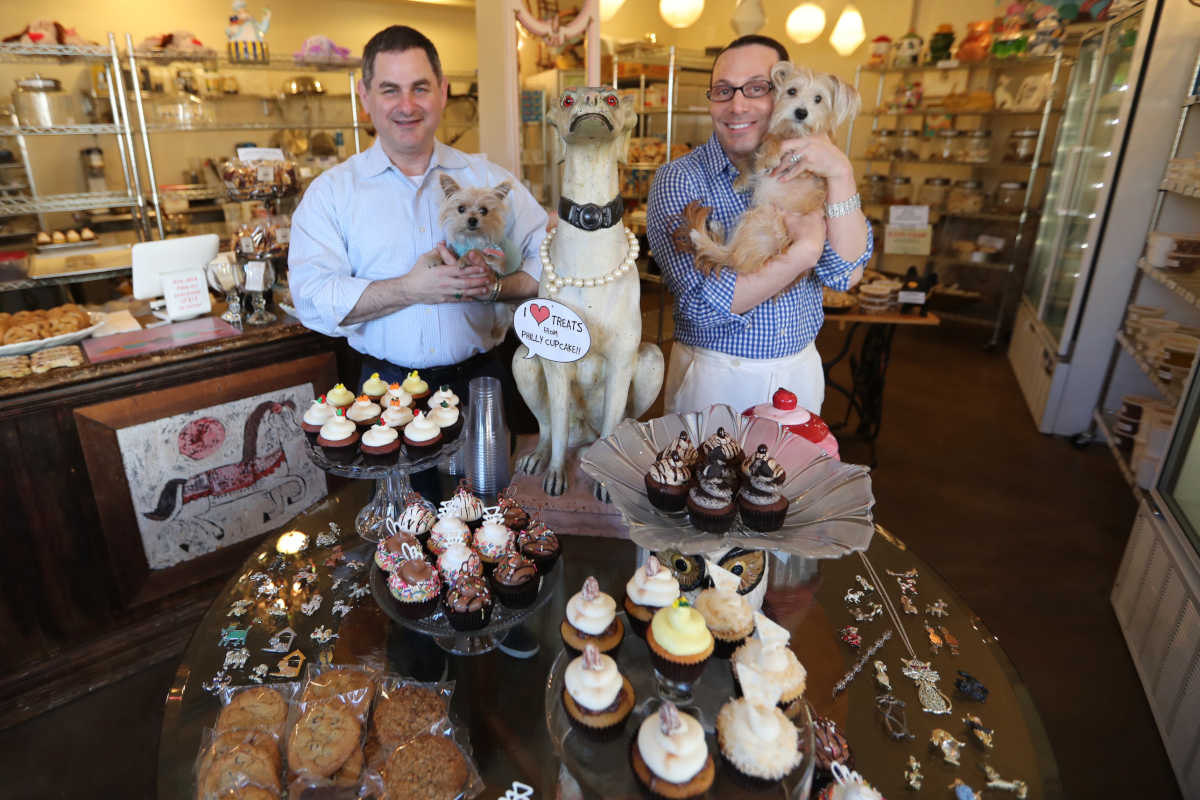 Johnny Columbo ( R ) holding Apricot and Michael Lewis holding Clinton at Philly Pupcake Friday February 25, 2017. ( DAVID SWANSON / Staff Photographer )