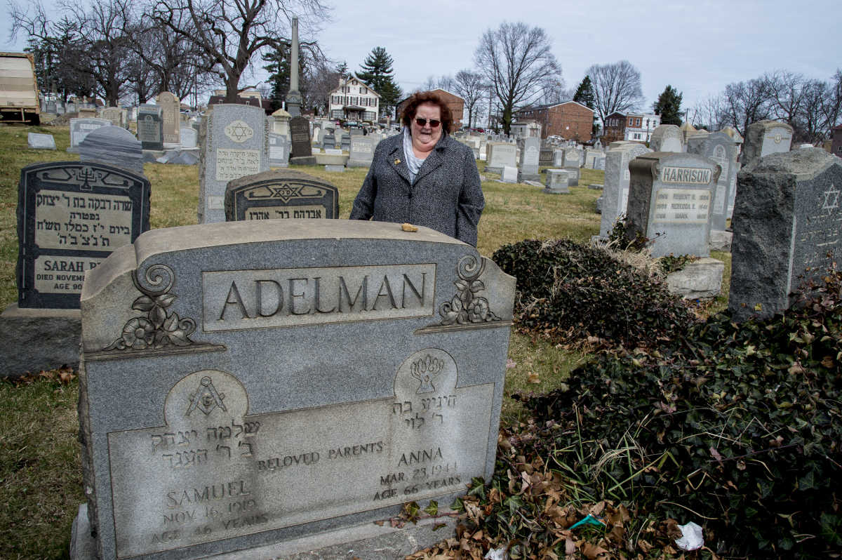 Judi Pogachefsky finds the headstone for her great grandparents' grave site the Mt. Carmel Cemetery is still standing on Monday.
