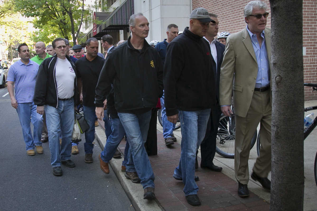 Union officials lead their members past a picket line set up at the Pennsylvania Convention Center in May 2014. In front is John Dougherty, who heads IBEW Local 98.