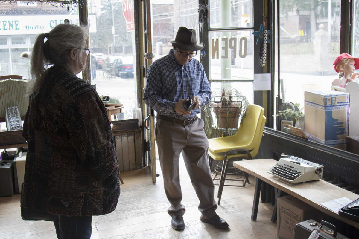Bryan Kravitz (right) talks about the typewriter Megan Hicks (left) brought to the shop in Mount Airy.