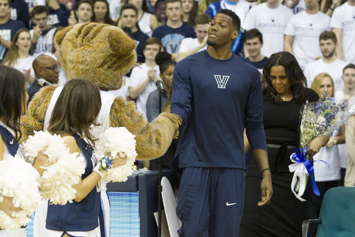 In a pregame ceremony in which Villanova honored its three seniors, Darryl Reynolds greets the mascot on Feb. 25, 2017