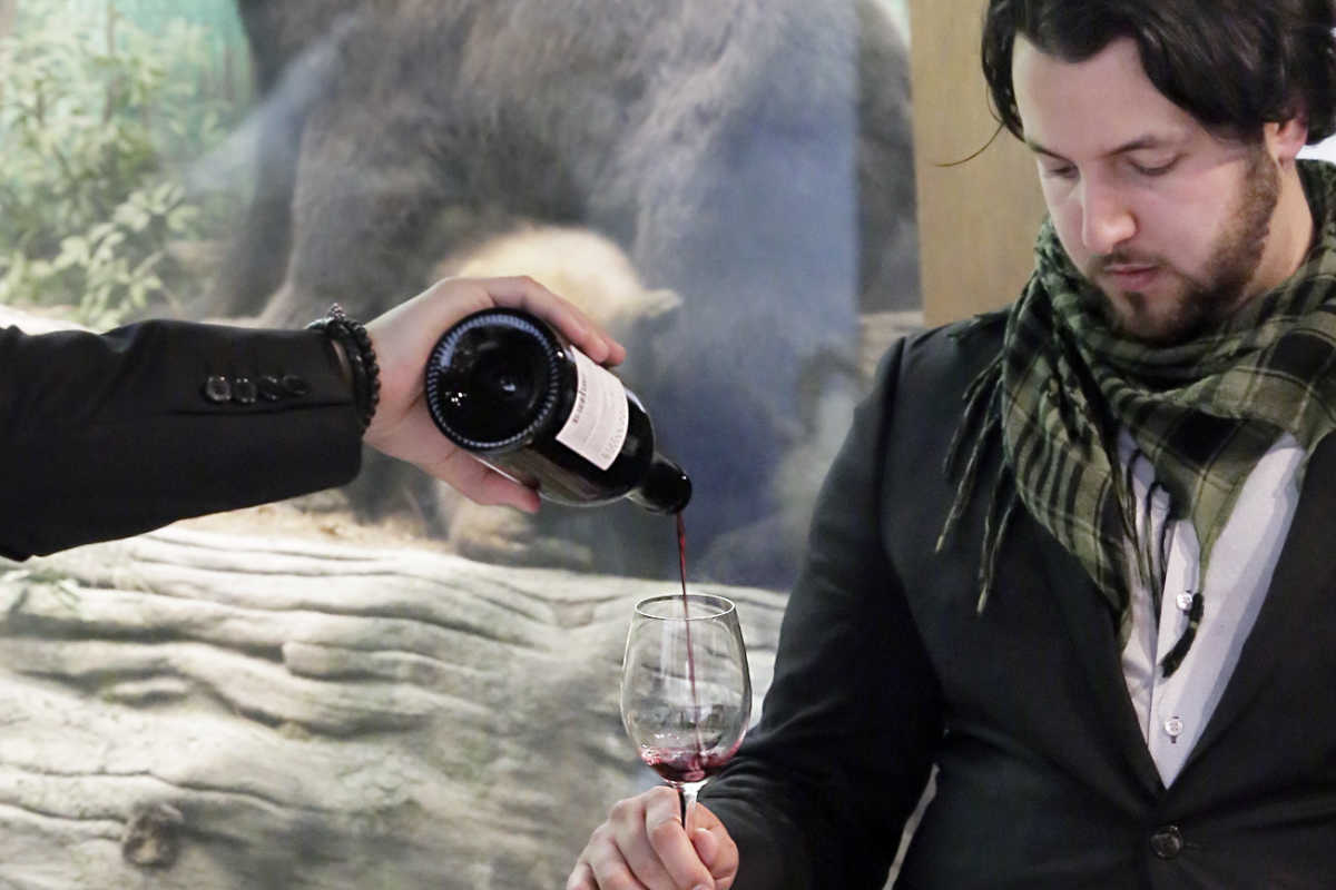 Nick Amrani of Philadelphia samples Soilair, an Austrian wine, during Philly Wine Week´s opening cork event at the Academy of Natural Sciences in Philadelphia on March 19, 2017.