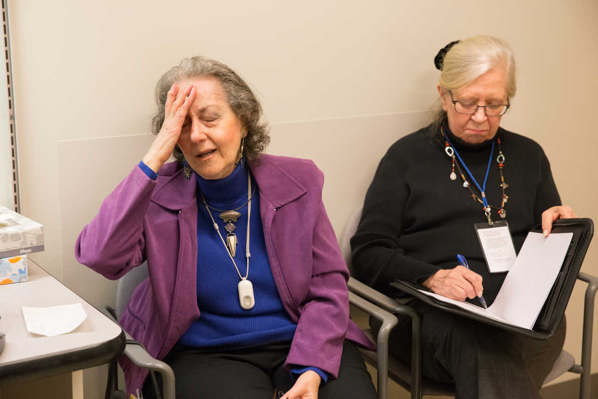 "Patient Elaine Nettis, left, describes her headache while her volunteer ""health pal,"" Marianne Waller, takes notes during an appointment at the Jefferson Headache Center."