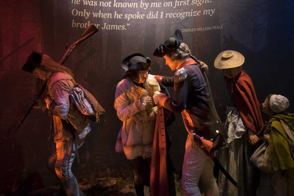 Philadelphia's famous artist-brothers James Peale and Charles Willson Peale, reuniting on the banks of the Delaware River in December 1776 in a tableau at the Museum of the American Revolution. Also in this tableau are a woman camp-follower and her child.   ED HILLE . Staff Photographer