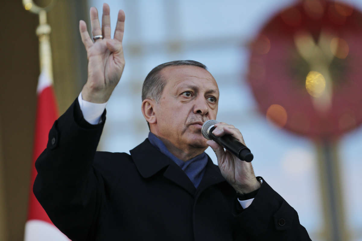Turkey President Recep Tayyip Erdogan delivers a speech during a rally of supporters a day after the referendum, outside the Presidential Palace, in Ankara, Turkey