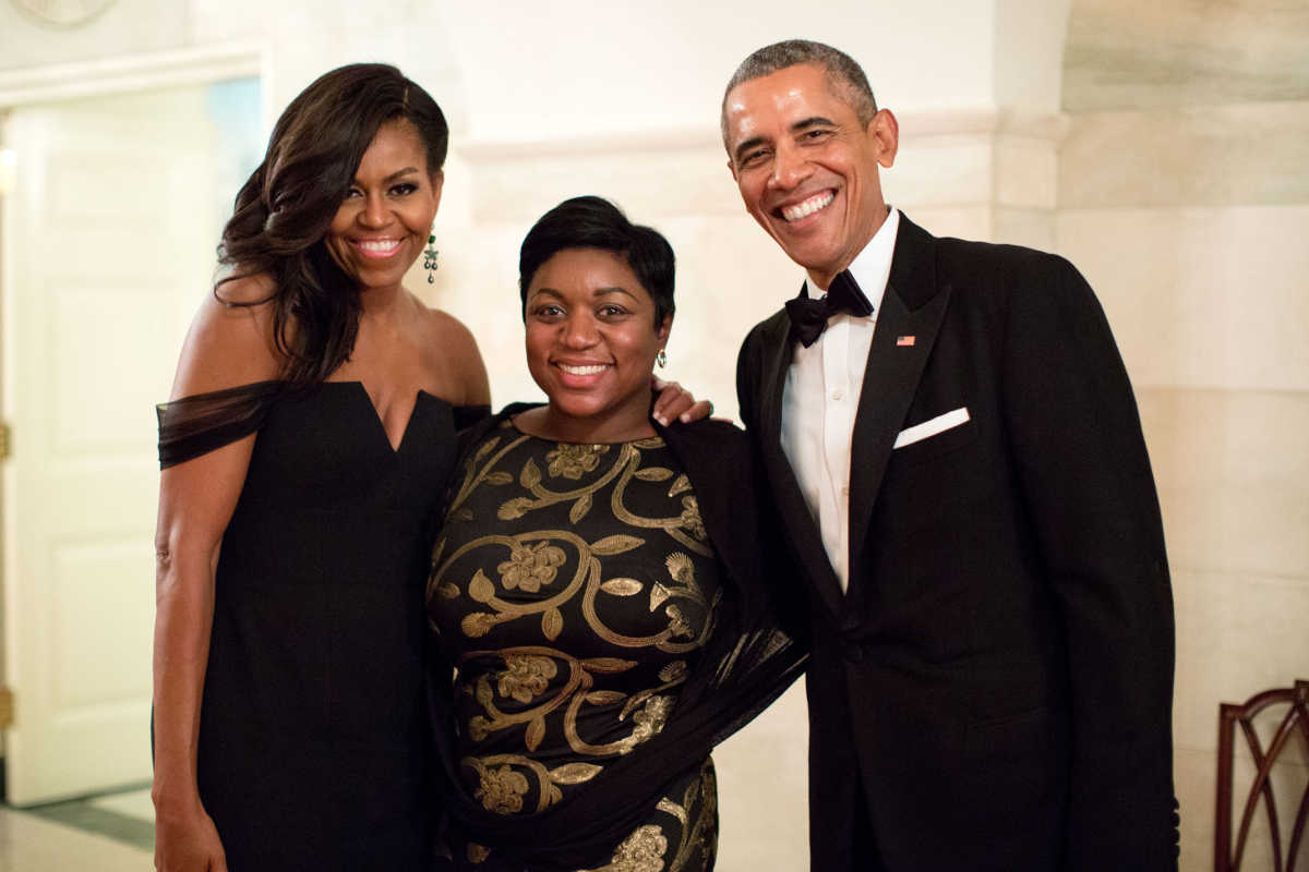 President Barack Obama and First Lady Michelle Obama pose with Social Secretary Deesha Dyer following a State Dinner at the White House, Sept. 25, 2015.