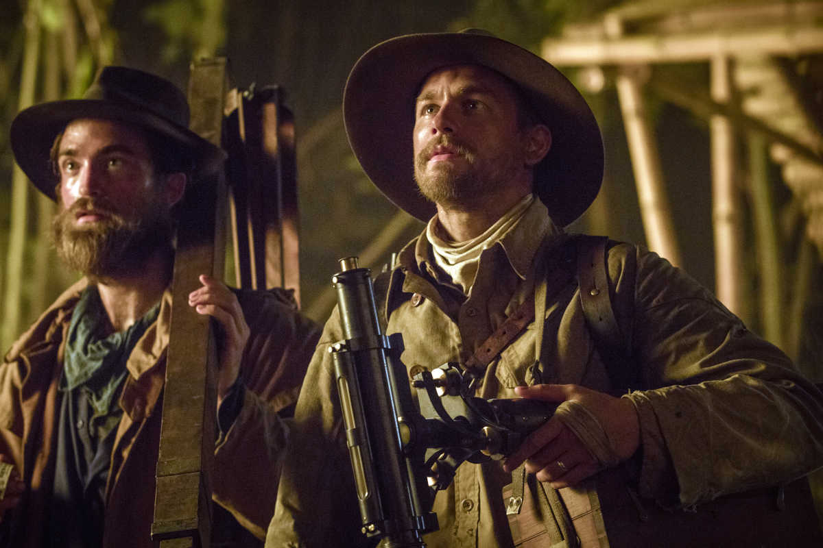 Robert Pattinson (left) stars as Henry Costin and Charlie Hunnam (right) stars as Percy Fawcett in 'The Lost City of Z.'