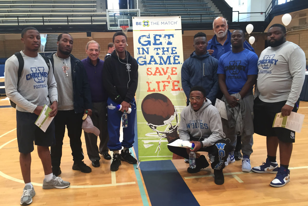 "Former Villanova football coach Andy Talley (third from left) and Cheyney coach Chris Rouhlac (third from right) with Cheyney players who came to the Main Line to help with the ""Get in the Game, Save a Life"" bone-marrow donor  program."