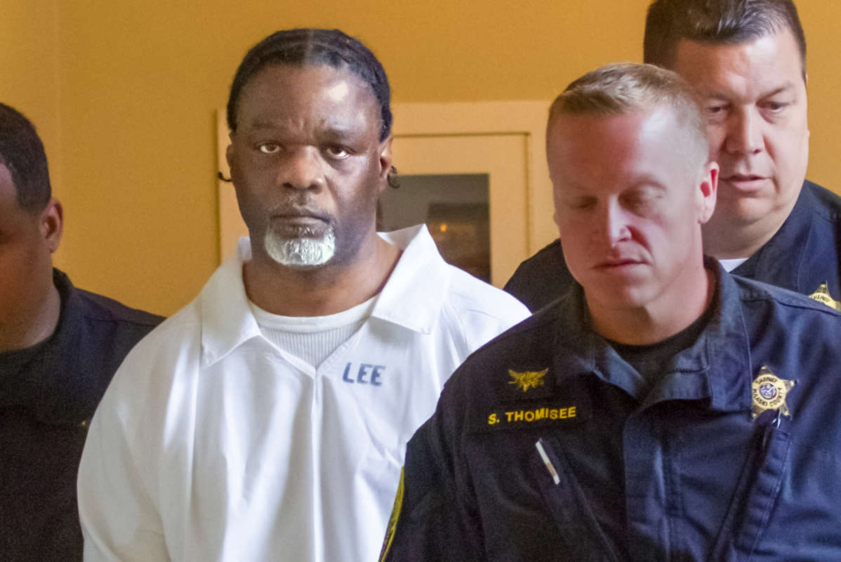 Ledell Lee is escorted by officers to an appearance in Pulaski County, Ark., Circuit Court on Tuesday.