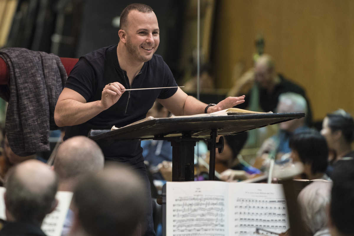 "Yannick Nézet-Séguin conducts during a rehearsal for the Metropolitan Opera production of Wagner's ""The Flying Dutchman."" (Photo: : Jonathan Tichler / Metropolitan Opera, 2017)"