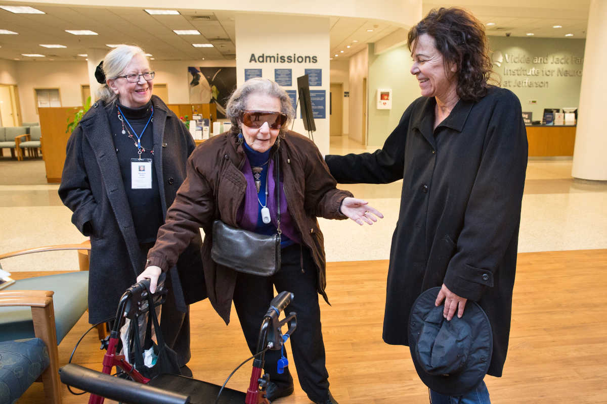Stella Buccella, a volunteer driver with Penn's Village, a Center City community group, brought Elaine Nettis, center, to her appointment at Jefferson Headache Center. Health pal Marianne Waller, left, met them in the lobby.