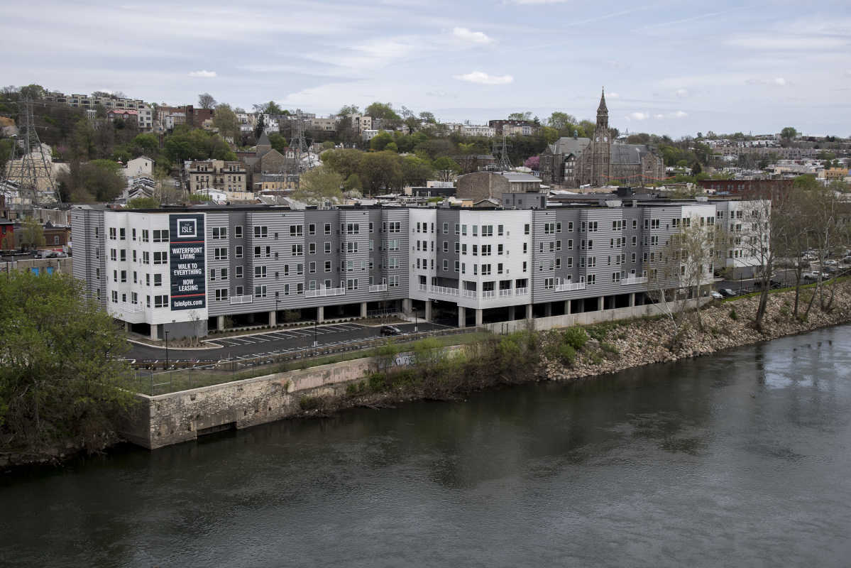 Manayunk has long been known for its village-esque character, dominated by churches, mom-and-pop stores and rowhomes. Yet now, it's the latest to see large, sprawling apartment complexes take shape. Pictured is the The Isle apartment building.