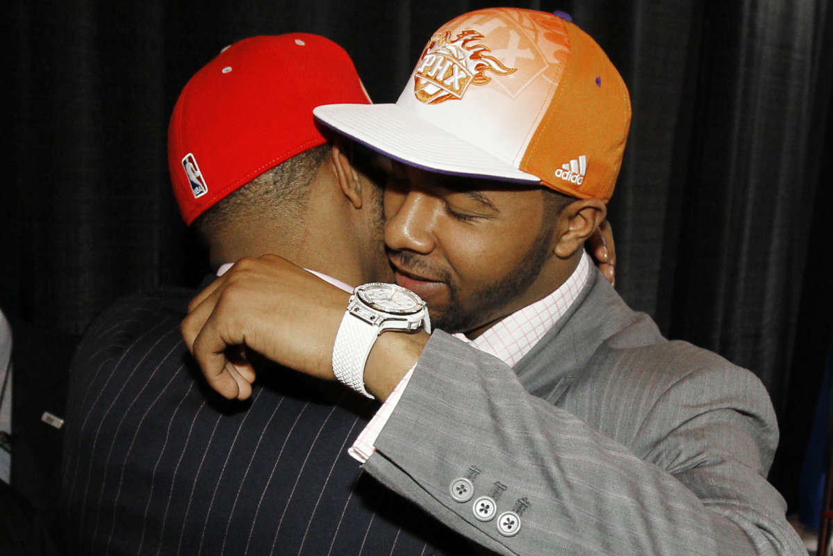 Twin brothers Markieff Morris (right) and Marcus Morris embrace after they were picked 13th and 14th, respectively, in the 2011 NBA draft.