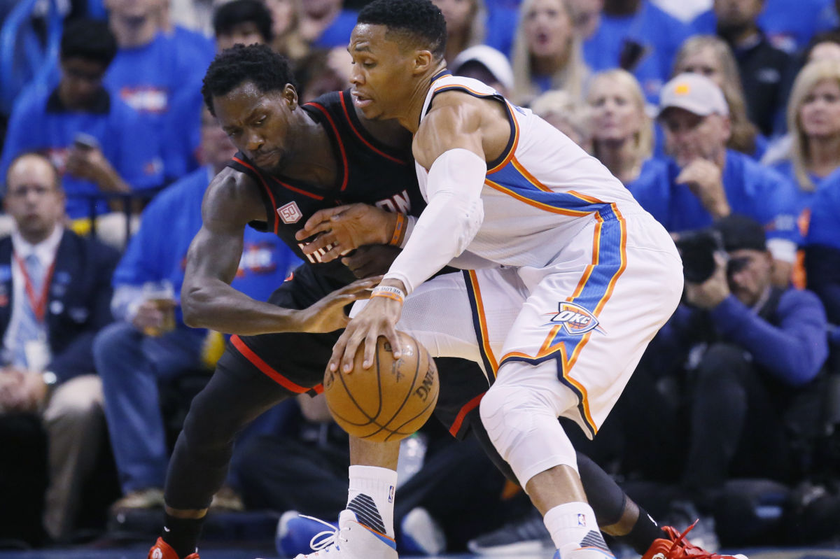 Thunder guard Russell Westbrook drives around the Rockets´  Patrick Beverley in the first quarter of Game 3 of their first-round NBA playoff series.