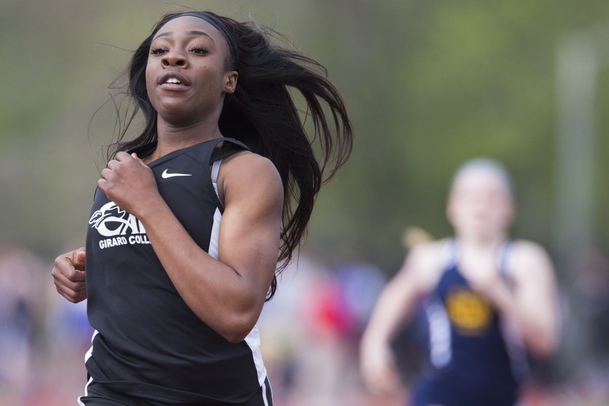 Girard College sophomore sprinter Thelma Davies (left) crosses the finish line to win her preliminary heat of the girls 100m dash at the Abington Jack Armstrong Track Invitational on April 21, 2017.