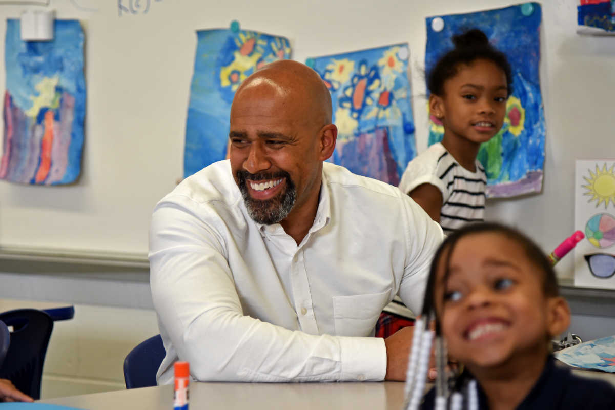 Miles Wilson, president and chief executive of EducationWorks, with kindergarten kids in the after school program at Grover Cleveland Mastery Charter School.