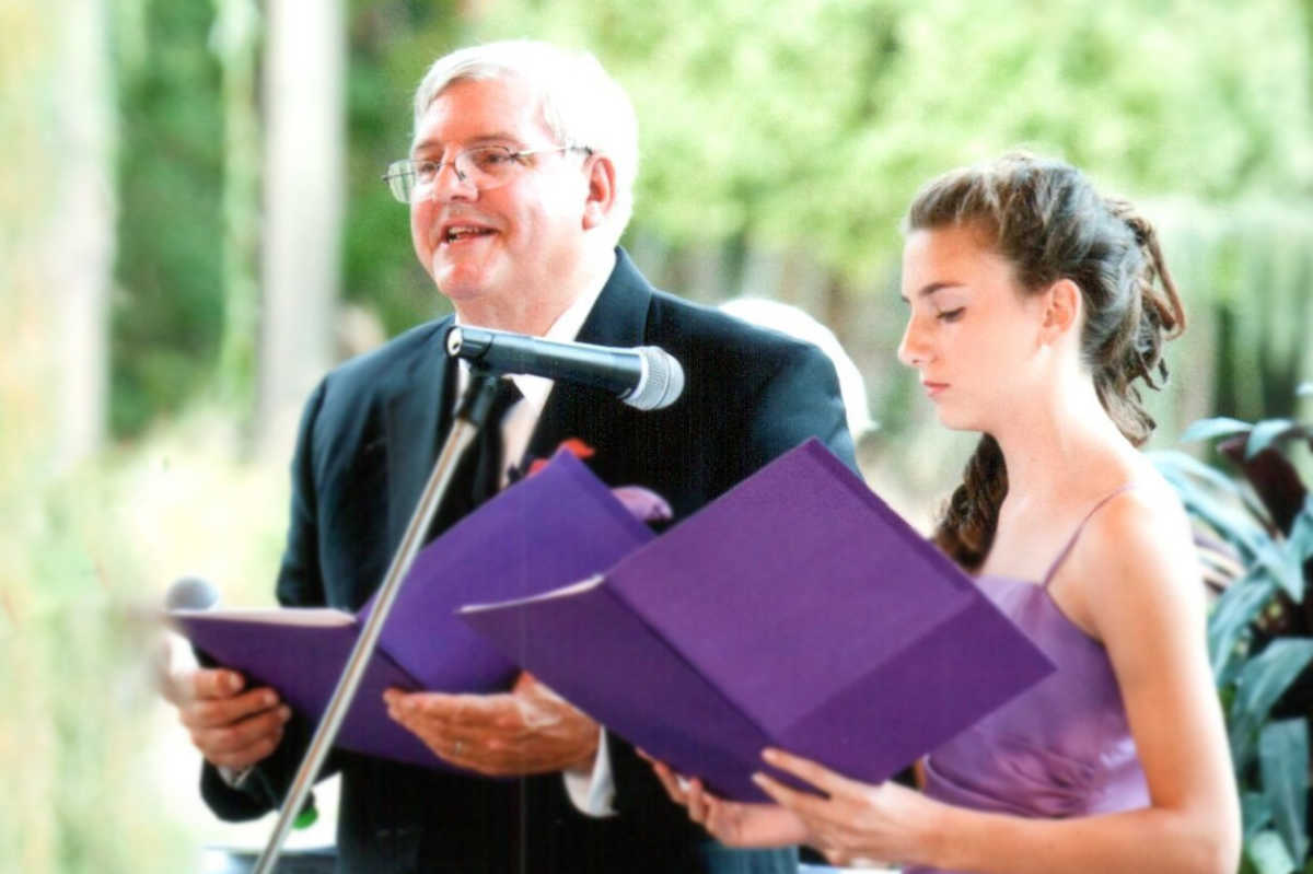 James Giosa singing with his granddaughter, Aly, at a family wedding.