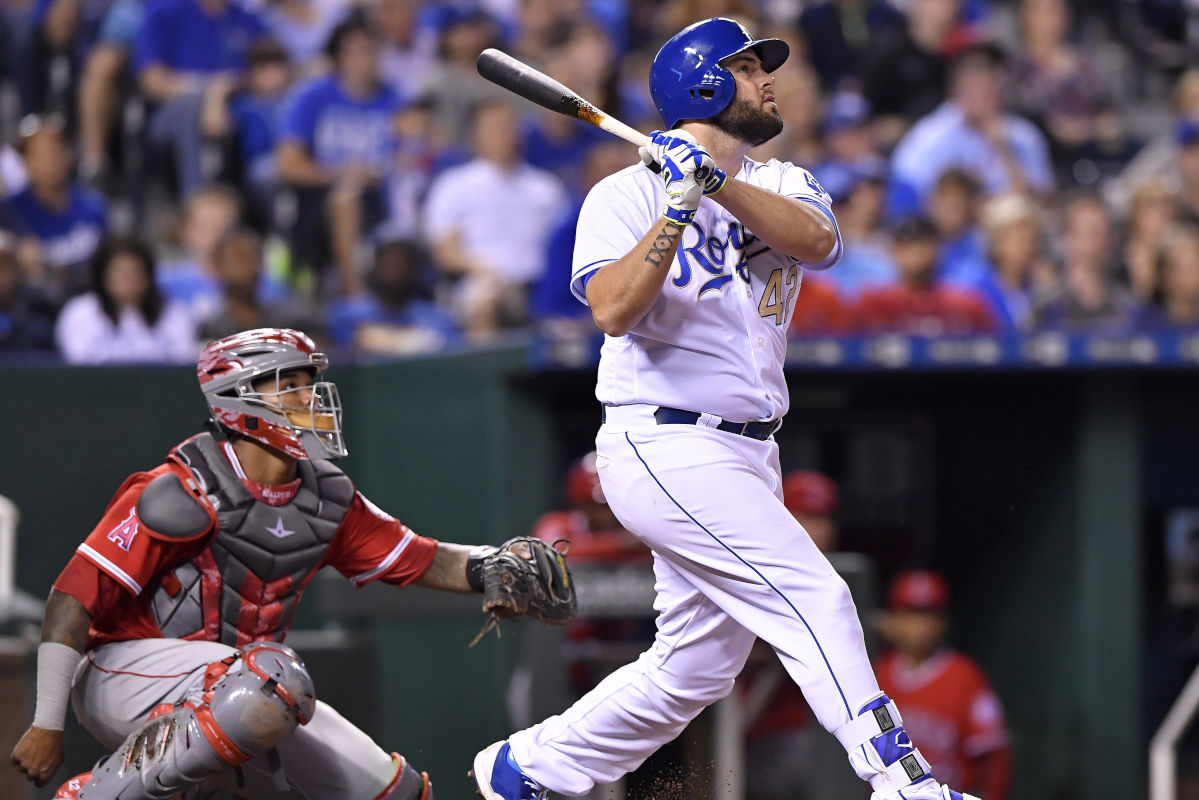 The Kansas City Royals´ Mike Moustakas follows through on a solo home run in the eighth inning against the Los Angeles Angels at Kauffman Stadium in Kansas City, Mo., on Saturday, April 15, 2017.