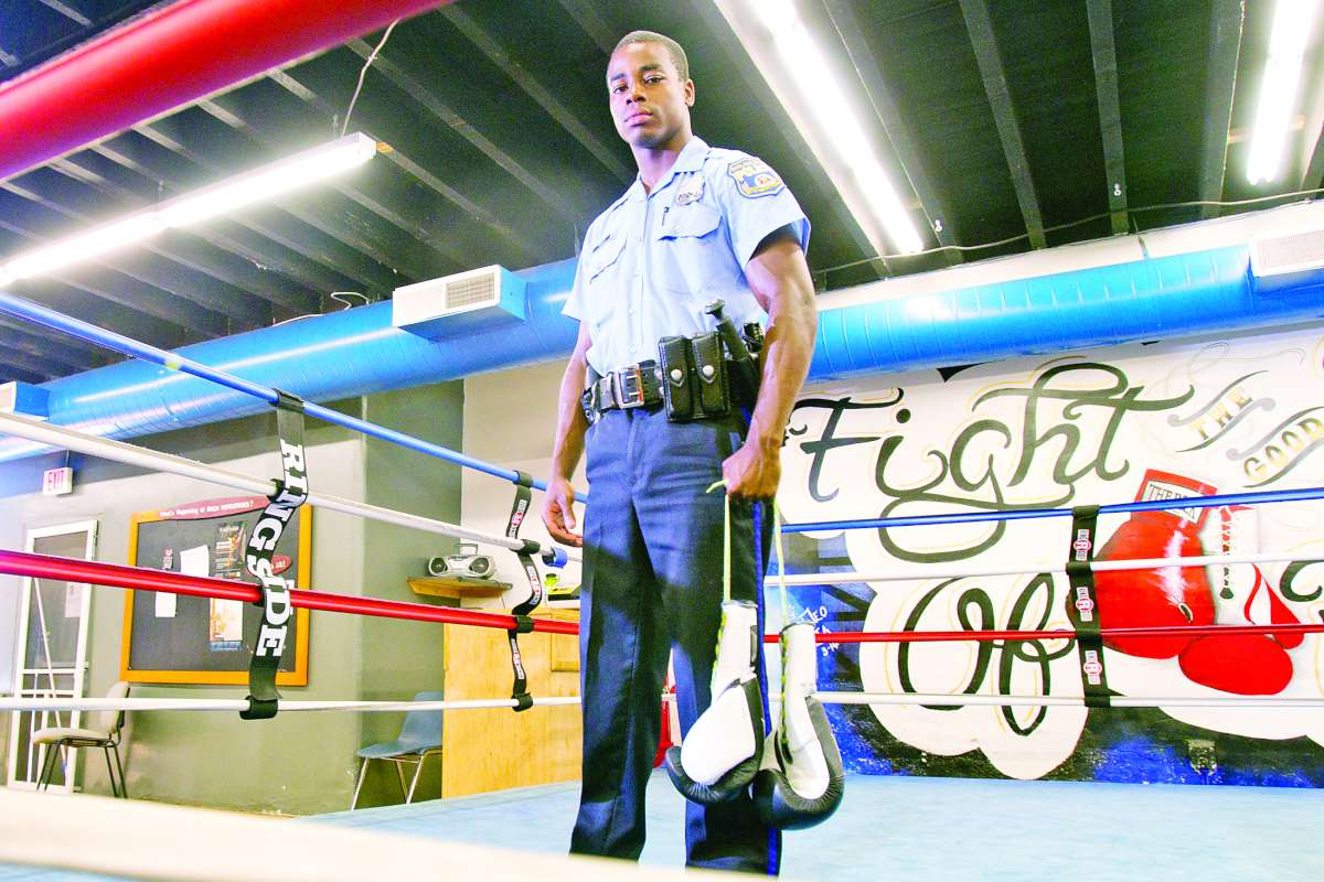 Emmanuel Folly in a boxing ring at Rock Ministries Gym.