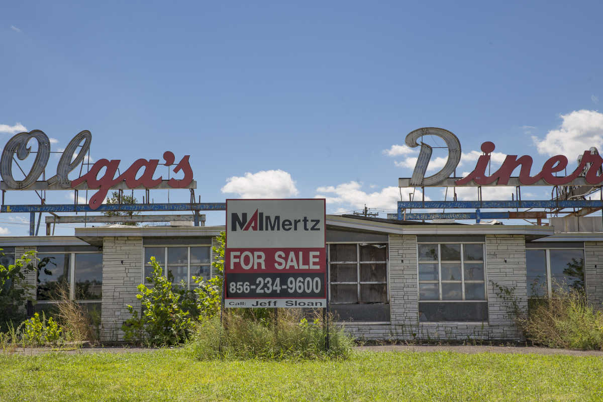 The long-shuttered Olga's Diner, in Evesham, is giving way to a fertility clinic. One of its giant signs, however, may find a new home in the township, the mayor and others hope.