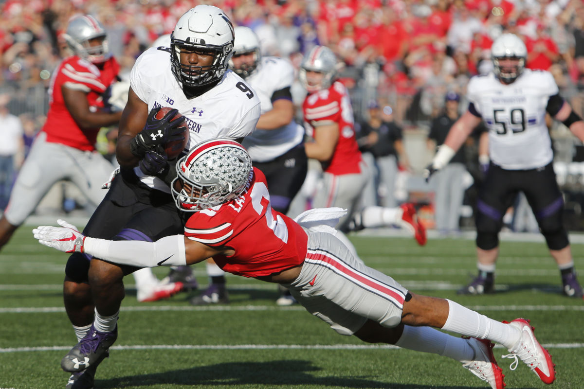 Ohio State cornerback Marshon Lattimore, shown here trying to tackle Northwestern running back Garrett Dickerson on Oct. 29, 2016, could be one of the first players chosen in the 2017 NFL draft.