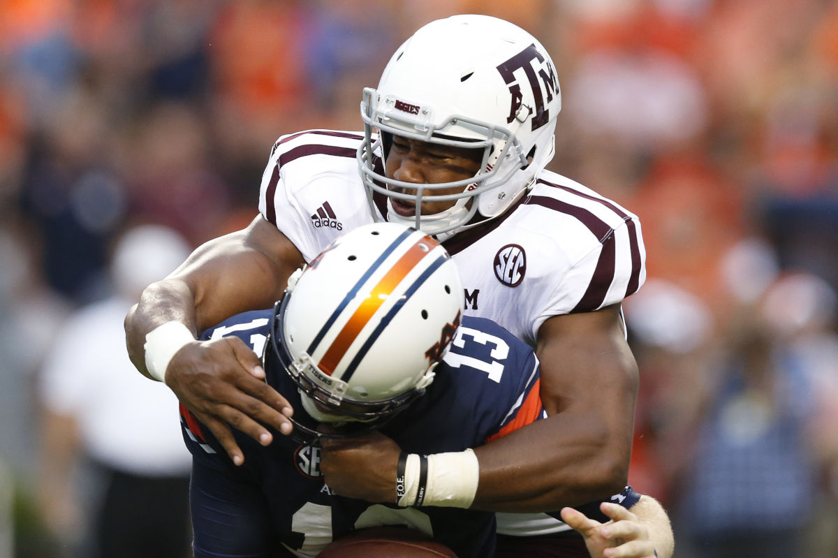 Texas A&M defensive end Myles Garrett (top), shown here sacking Auburn quarterback Sean White in a 2016 game, could be the first player chosen in the 2017 NFL draft.