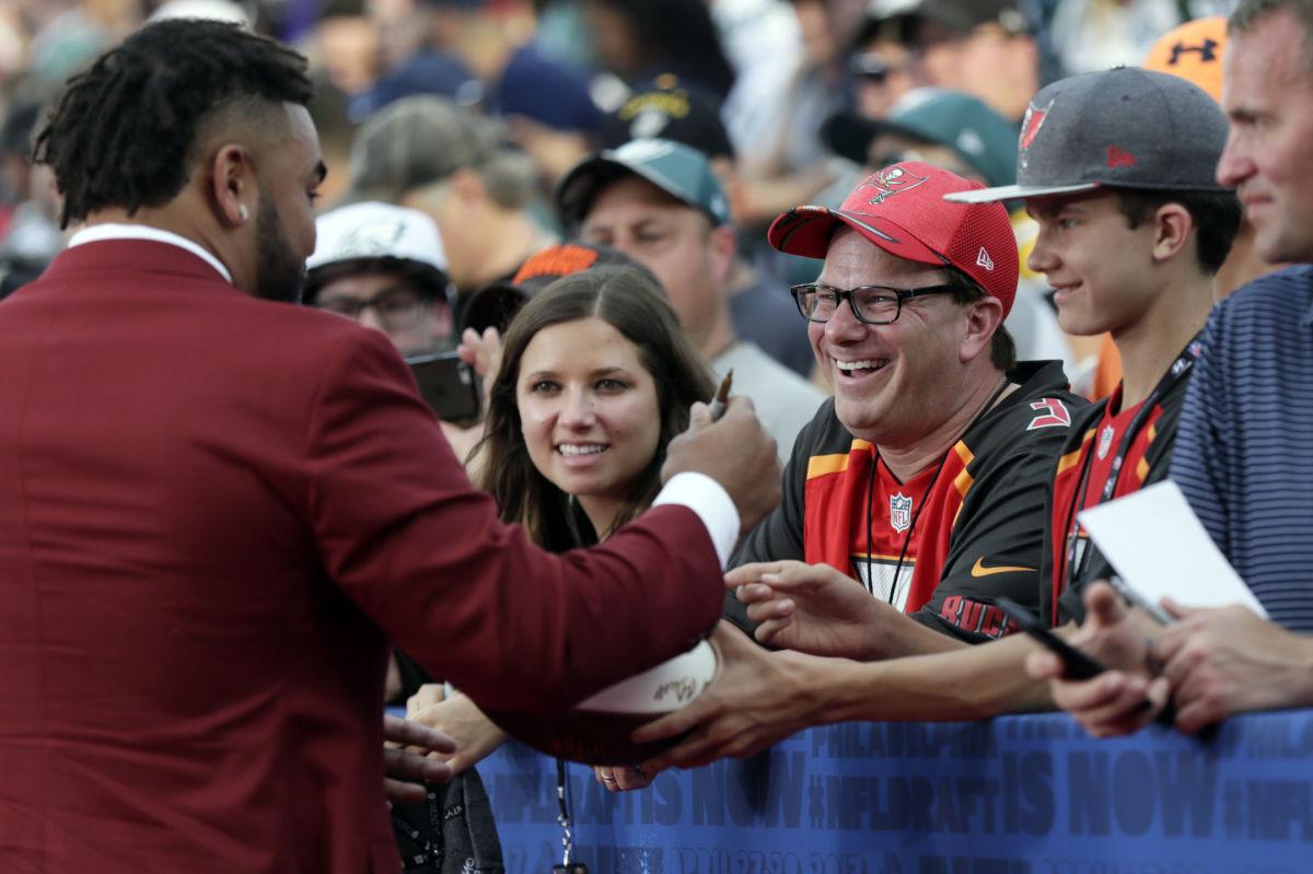 Derek Barnett signed autographs for fans as he arrived at the Philadelphia Museum of Art for the NFL draft first round on Thursday.