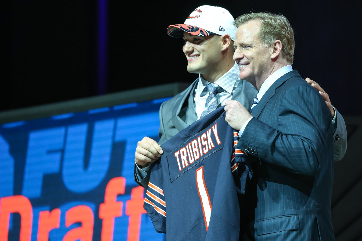 Mitchell Trubisky, selected by Chicago withe the No. 2 pick in the NFL draft, holds up Bears jersey while standing next to  commissioner Roger Goodell.<br />