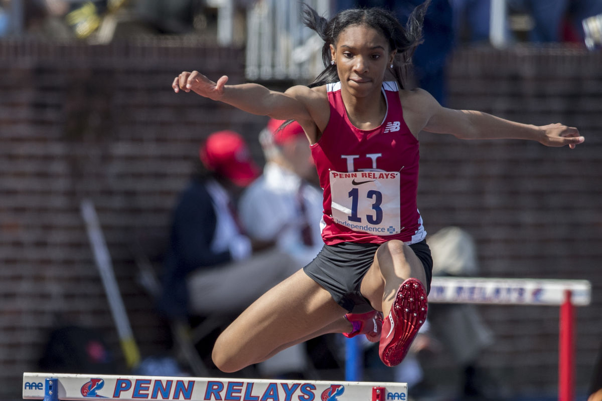 Upper Dublin's Madison Langley-Walker runs the 400-meter hurdles event at the 123rd Penn Relays at Franklin Field on Thursday, April 27, 2017.  She finished in 1:01:98.