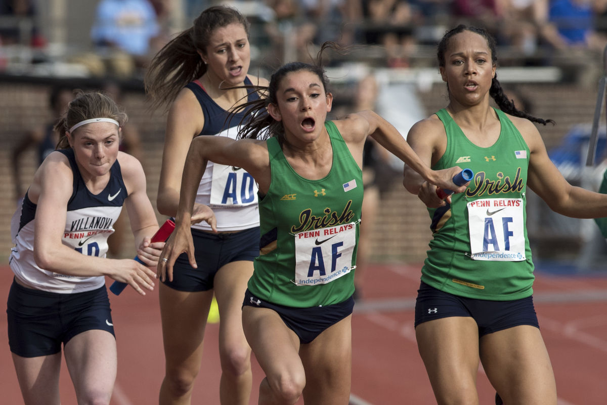 Villanova's Siofra Cleirigh Buttner (left) takes the baton from McKenna Keegan to start the 3rd leg of the college women's distance medley relay at the Penn Relays on Thursday, April 27, 2017.