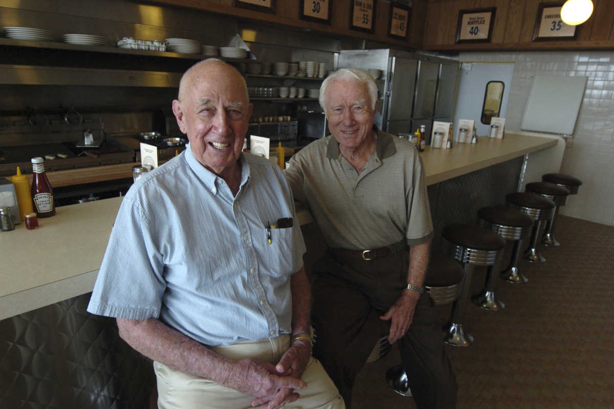 In this file photo taken Aug. 25, 2008, Waffle House Founders Joe Rogers Sr. (left) and Tom Forkner Sr. pose at the company's museum located on the site of the first Waffle House in Avondale Estates, Ga. Forkner, who jumped from real estate to the restaurant business when he co-founded Waffle House in the 1950s, has died weeks after the death of his business partner who helped him create the famous Southern diner chain. Waffle House said in a statement that Forkner died Wednesday at age 98.
