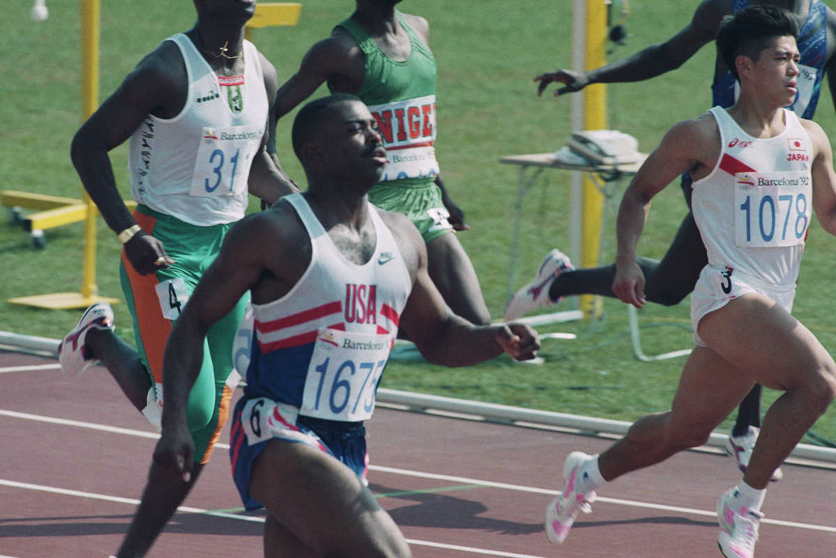 Japan's Satoru Inoue, right, finishes second behind Leroy Burrell of Houston, Texas, during the first heat of the men's 100-meter competition at the Summer Olympics in Barcelona, Friday, July 31, 1992.