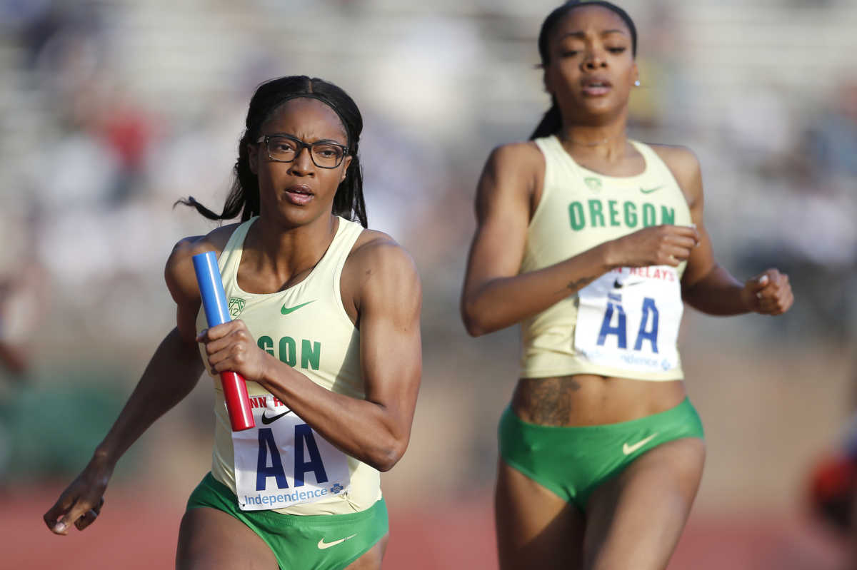 The Oregon women set a college record with their time in the College Women's Sprint Medley Championship of America on April 28, 2017 at Franklin Field. Hannah Waller, left, takes the handoff from Deajah Stevens to run the 3rd leg.